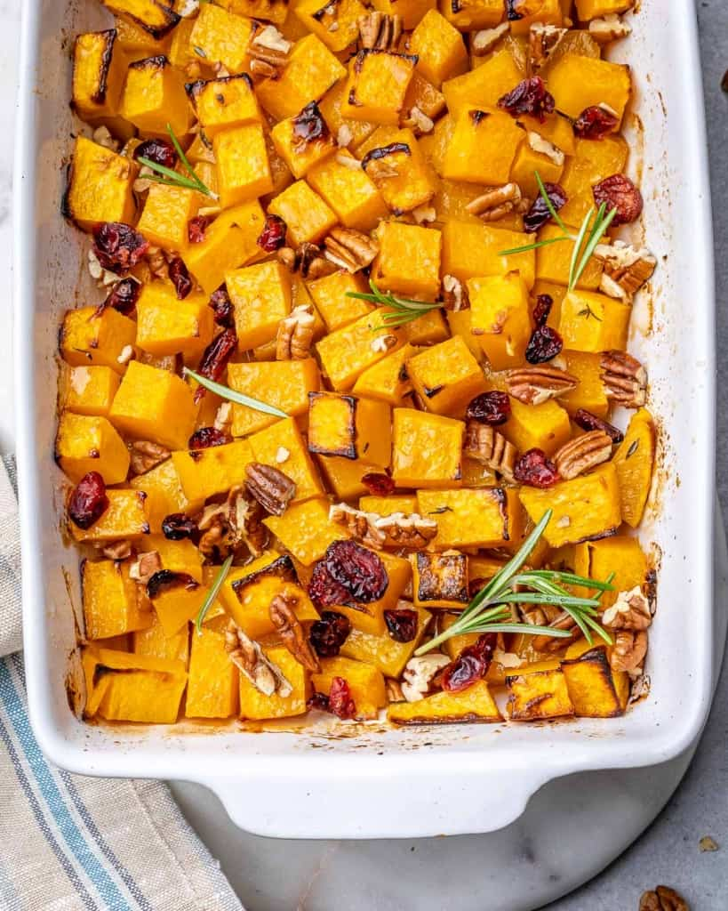 top view roasted butternut squash in a white baking dish
