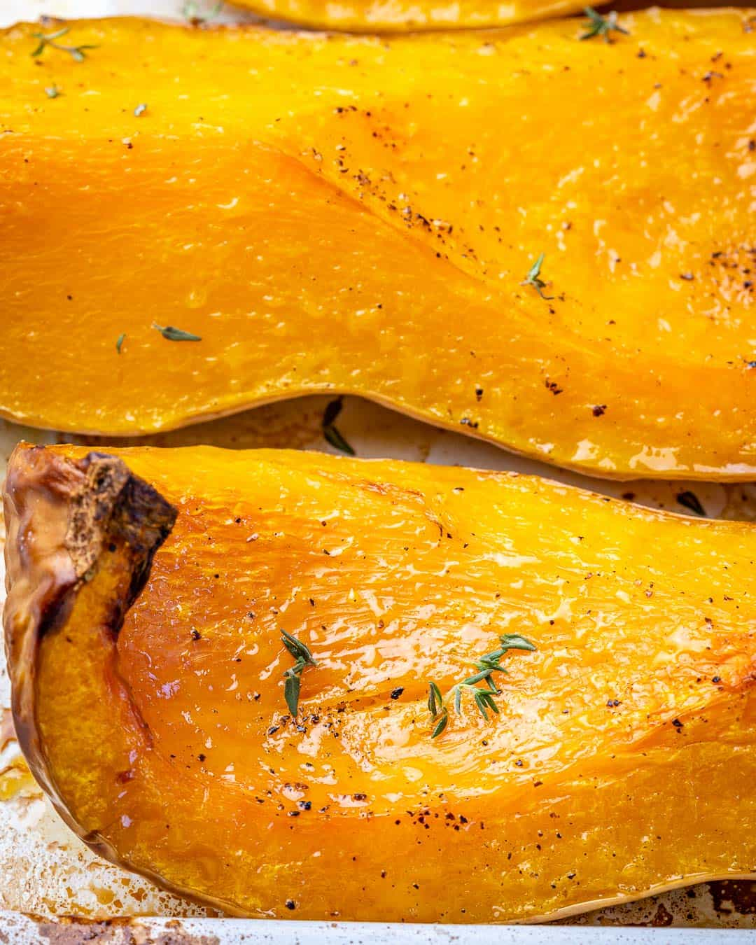 Close view of golden brown edges on roasted butternut squash