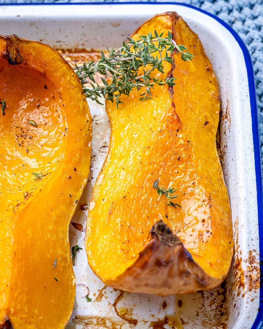Wedge of roasted butternut squash with fresh herbs