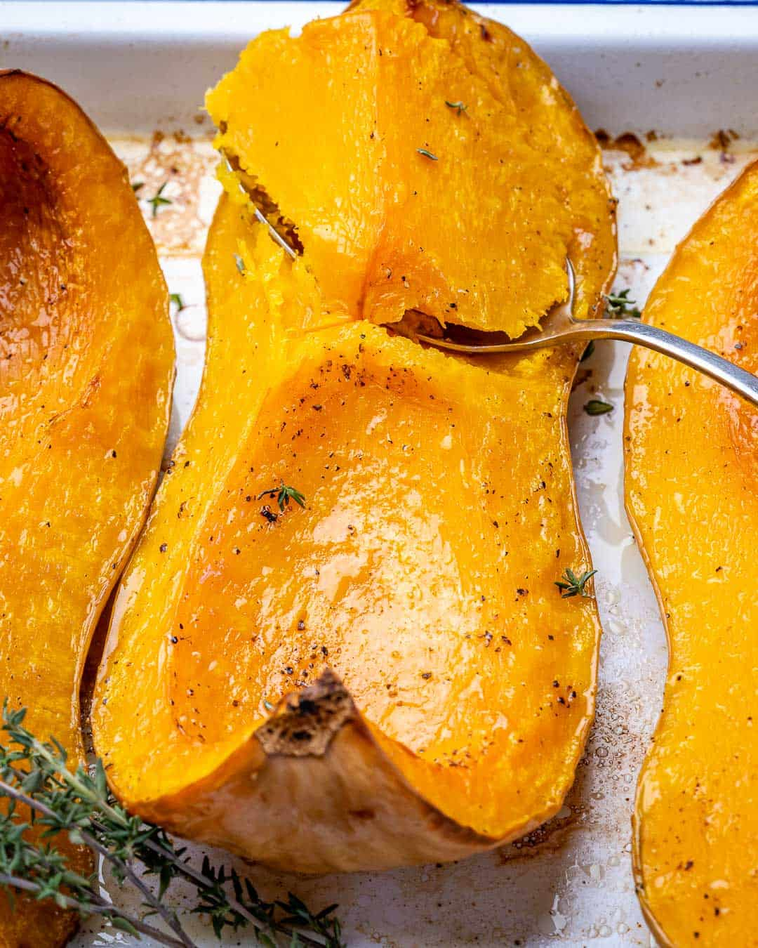 Spoon scooping out soft roasted butternut squash