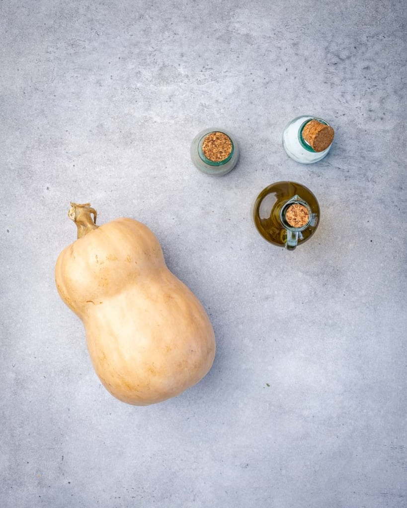 Ingredients for oven roasted butternut squash on counter