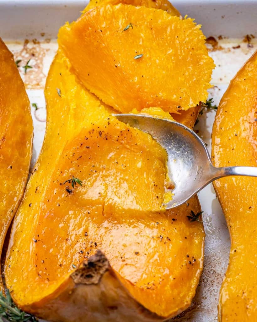 close up view of spoon scooping butternut squash