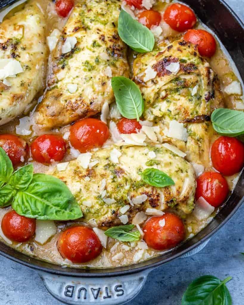 close up chicken breast in a pesto sauce
