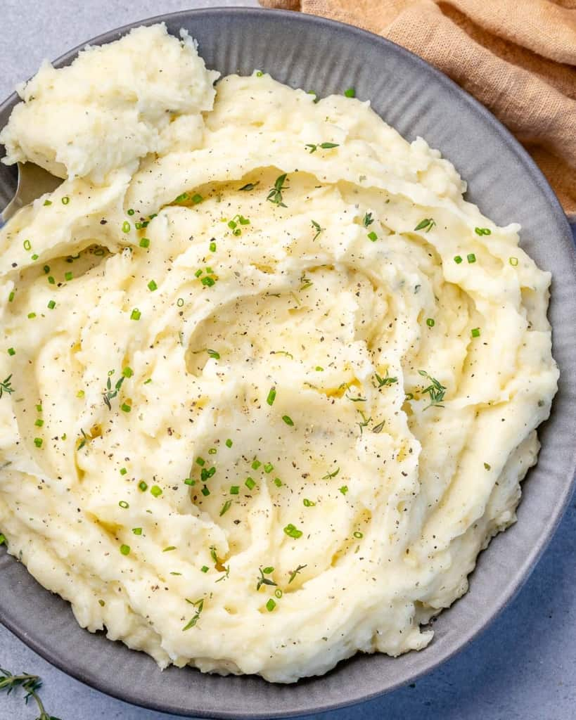 top view of mashed potatoes on a gray plate
