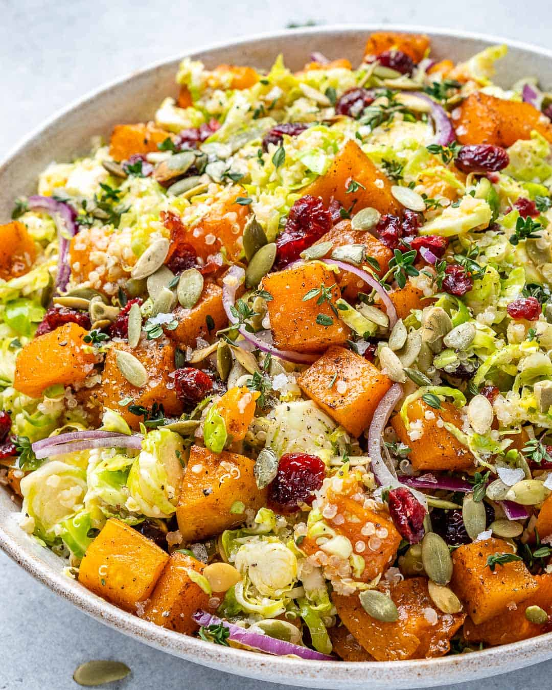Angled view of bowl with butternut squash salad.