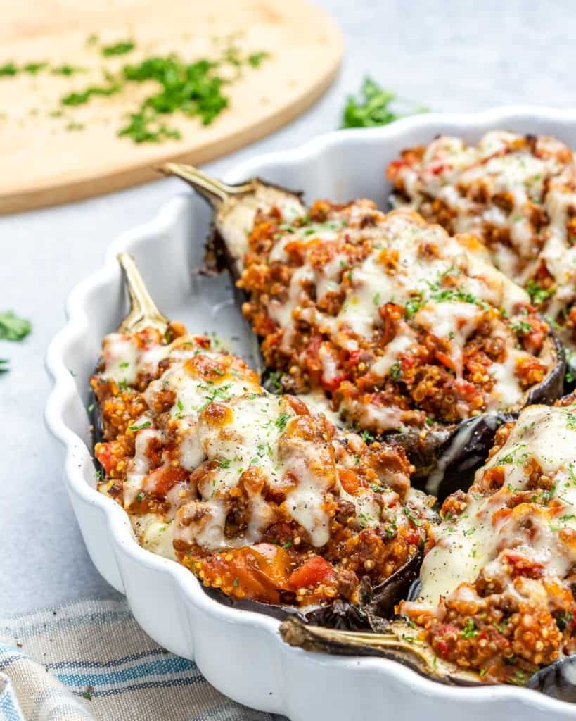 Stuffed eggplant on a table in a white dish