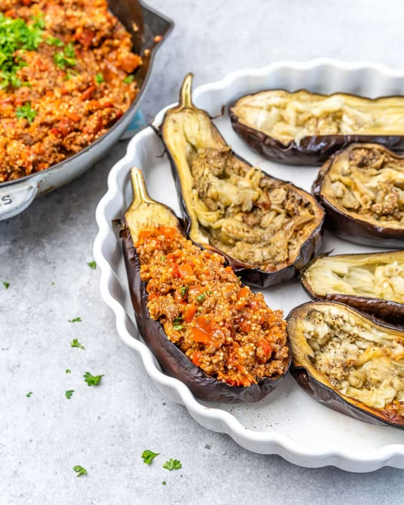 Eggplant with stuffing in a baking dish.