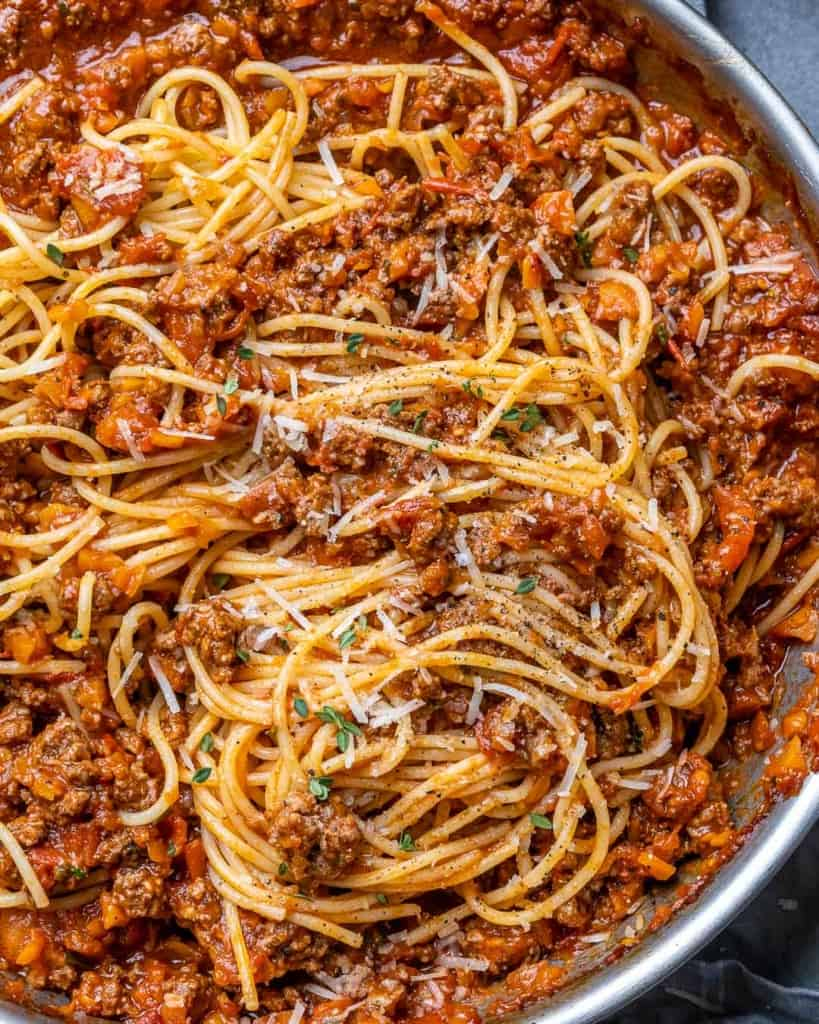 close up view of bolognese with spaghetti