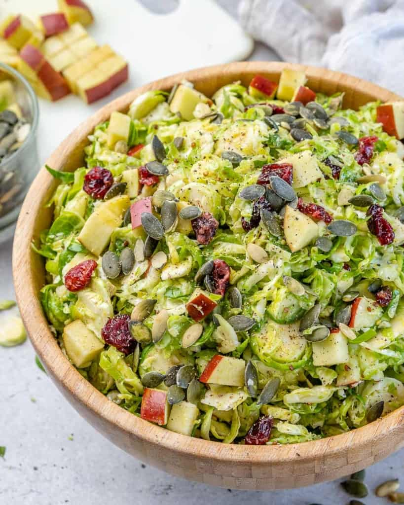 A brown bowl of Brussel sprouts salad.