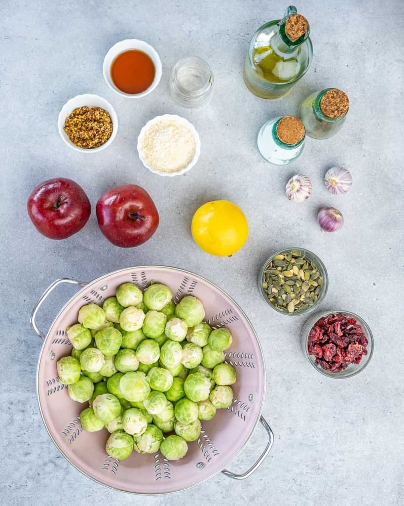 Overhead image of ingredients needed for a Brussels sprouts salad.