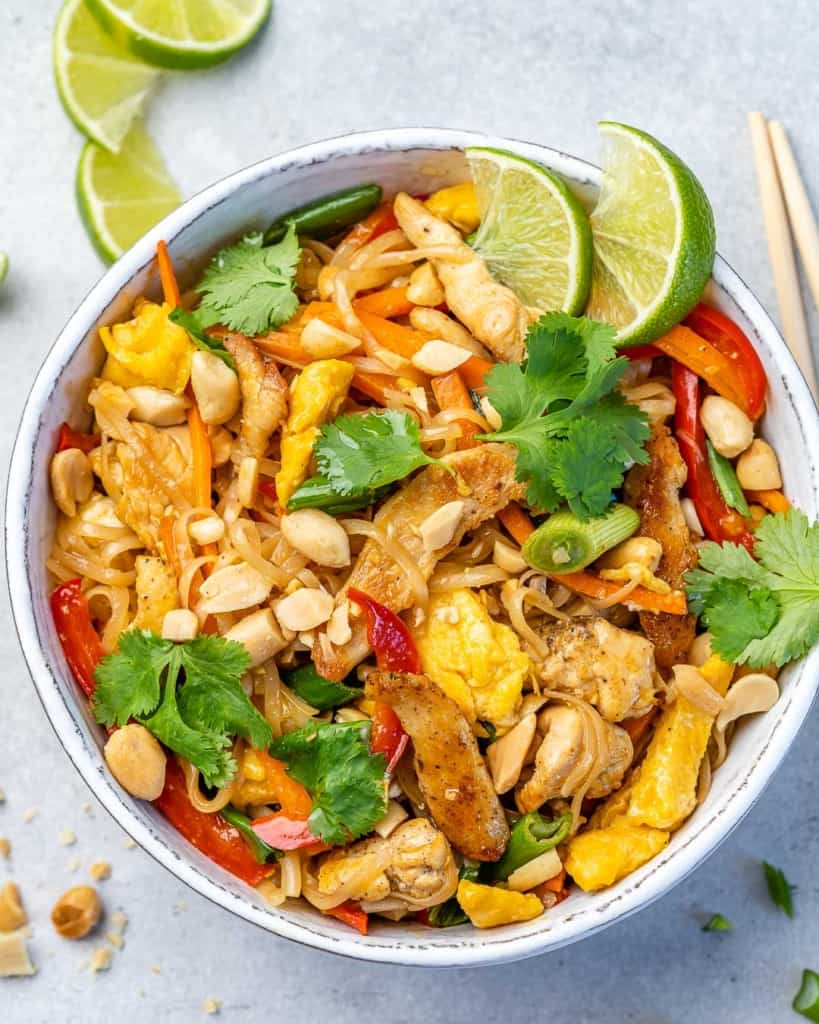 top view of chicken pad thai in white bowl