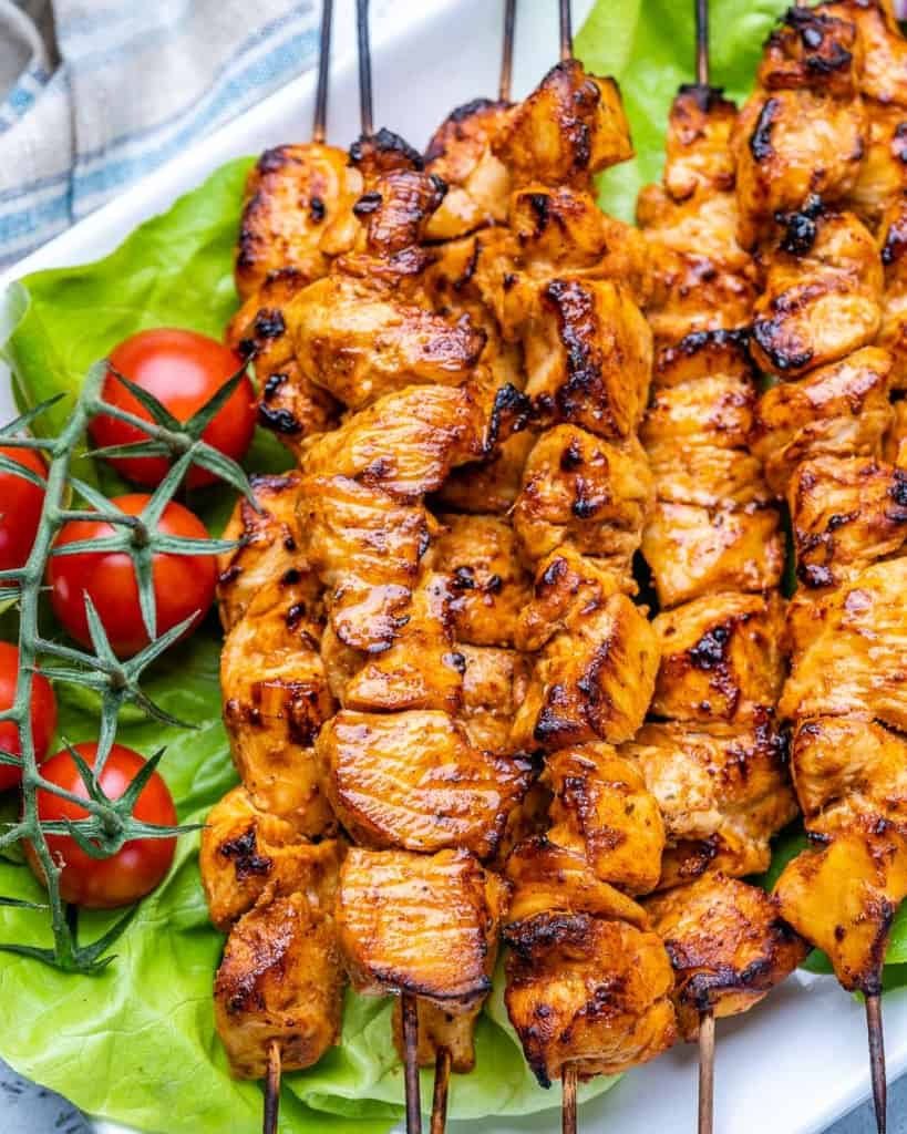 close up grilled shish tawook skewers on plate