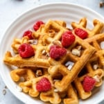 side shot keto waffles with raspberry garnish
