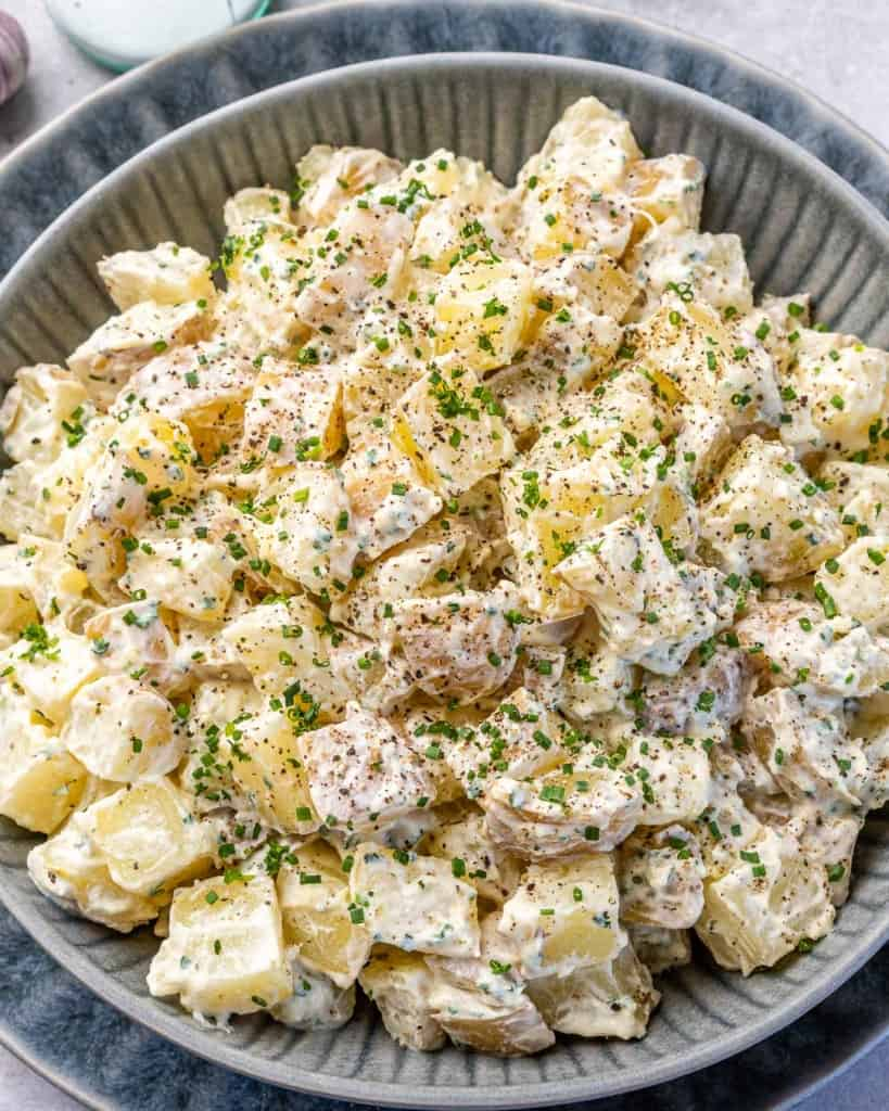 top view potato salad in gray plate