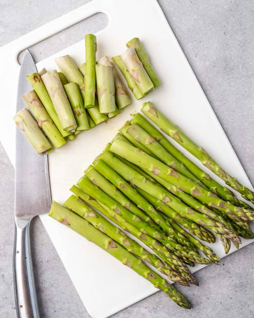 asparagus on white platter with ends trimmed out