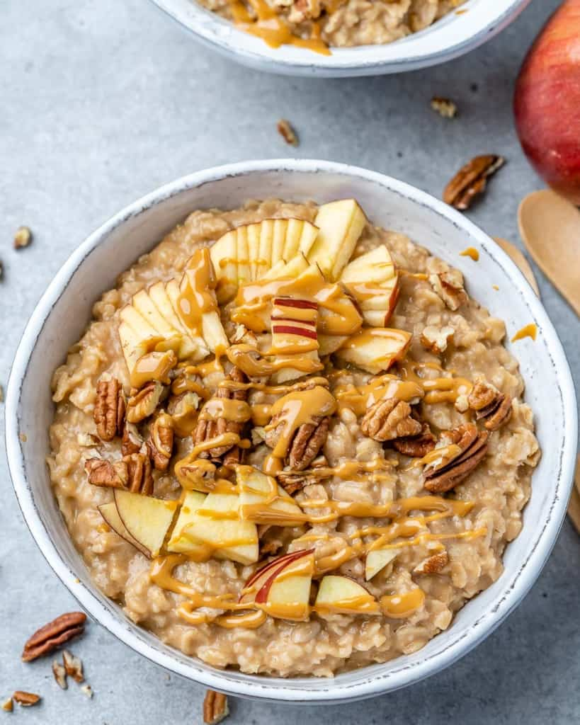 A bowl of peanut butter and banana oatmeal.