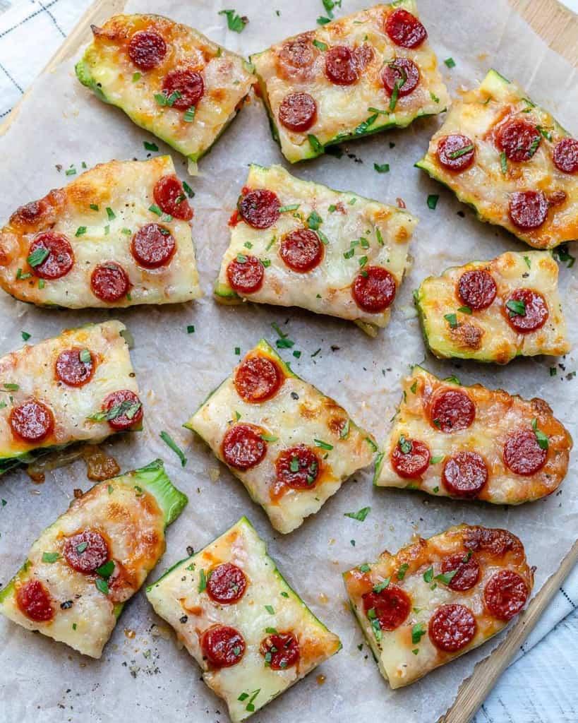 top view cut up zucchini pizza