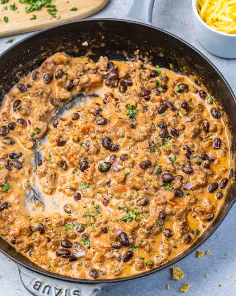 top view cowboy queso dip in a black pan