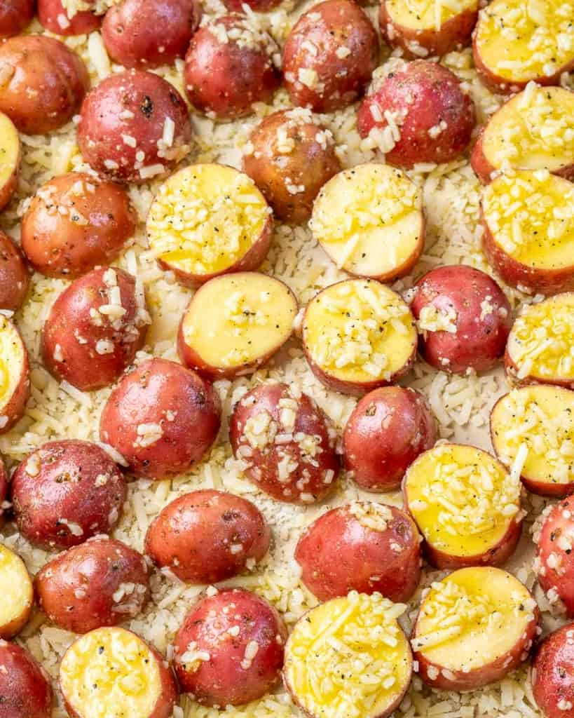 Process photo of potatoes topped with Parmesan cheese