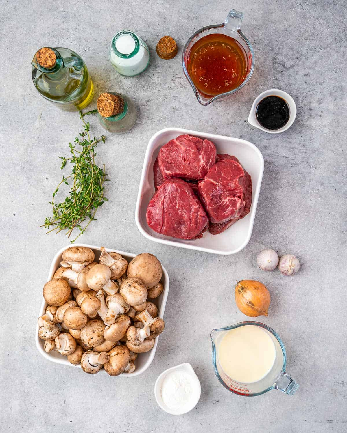 Ingredients for filet mignon and mushrooms on counter.