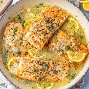 top view salmon piccata on an orange dish
