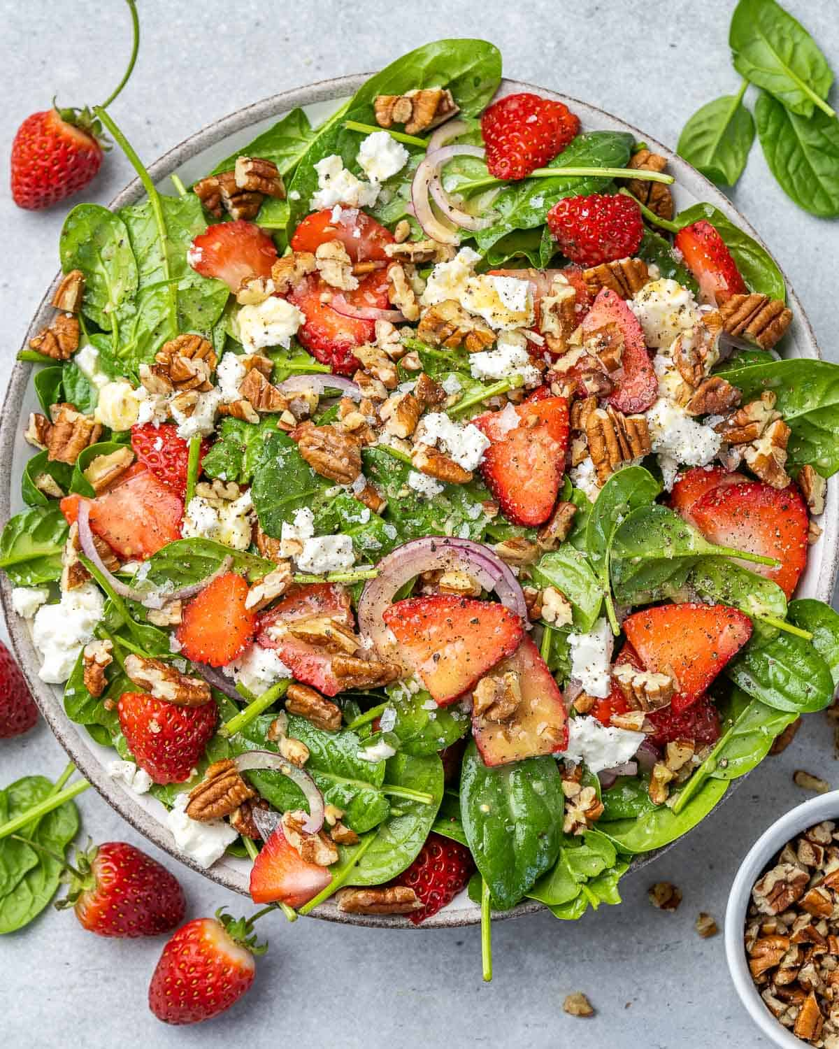 top view strawberry and spinach salad with pecans and feta