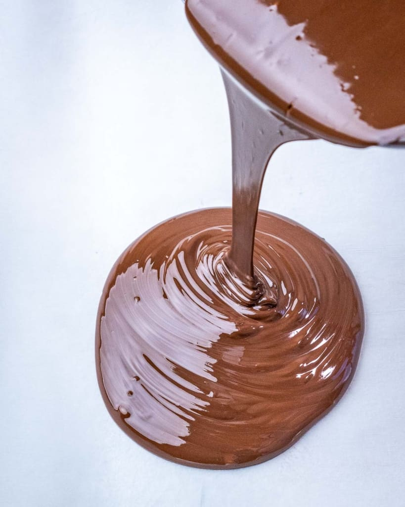 melted chocolate being poured on pan