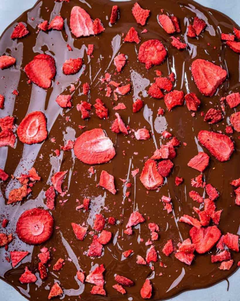 dried strawberries added over melted chocolate