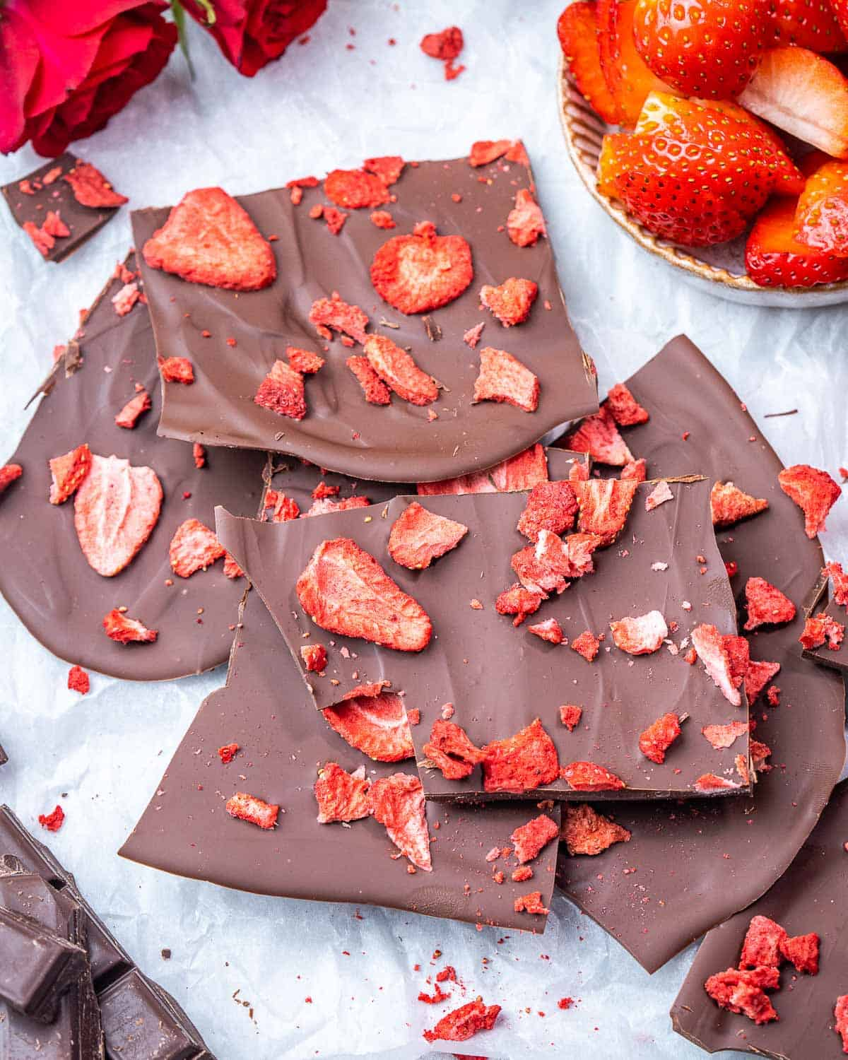 top view chocolate bark pieces topped with dried strawberries