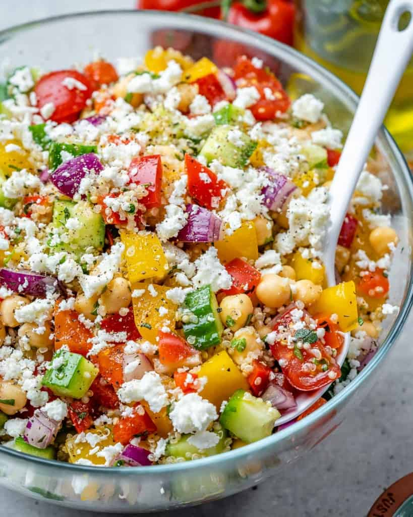 side shot quinoa veggie salad in a clear bowl