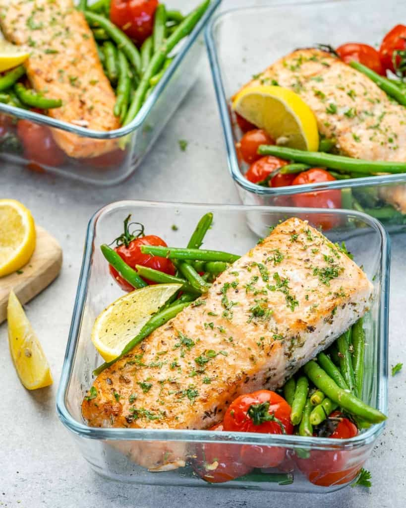 Salmon meal prep bowls with green beans and tomatoes with lemon