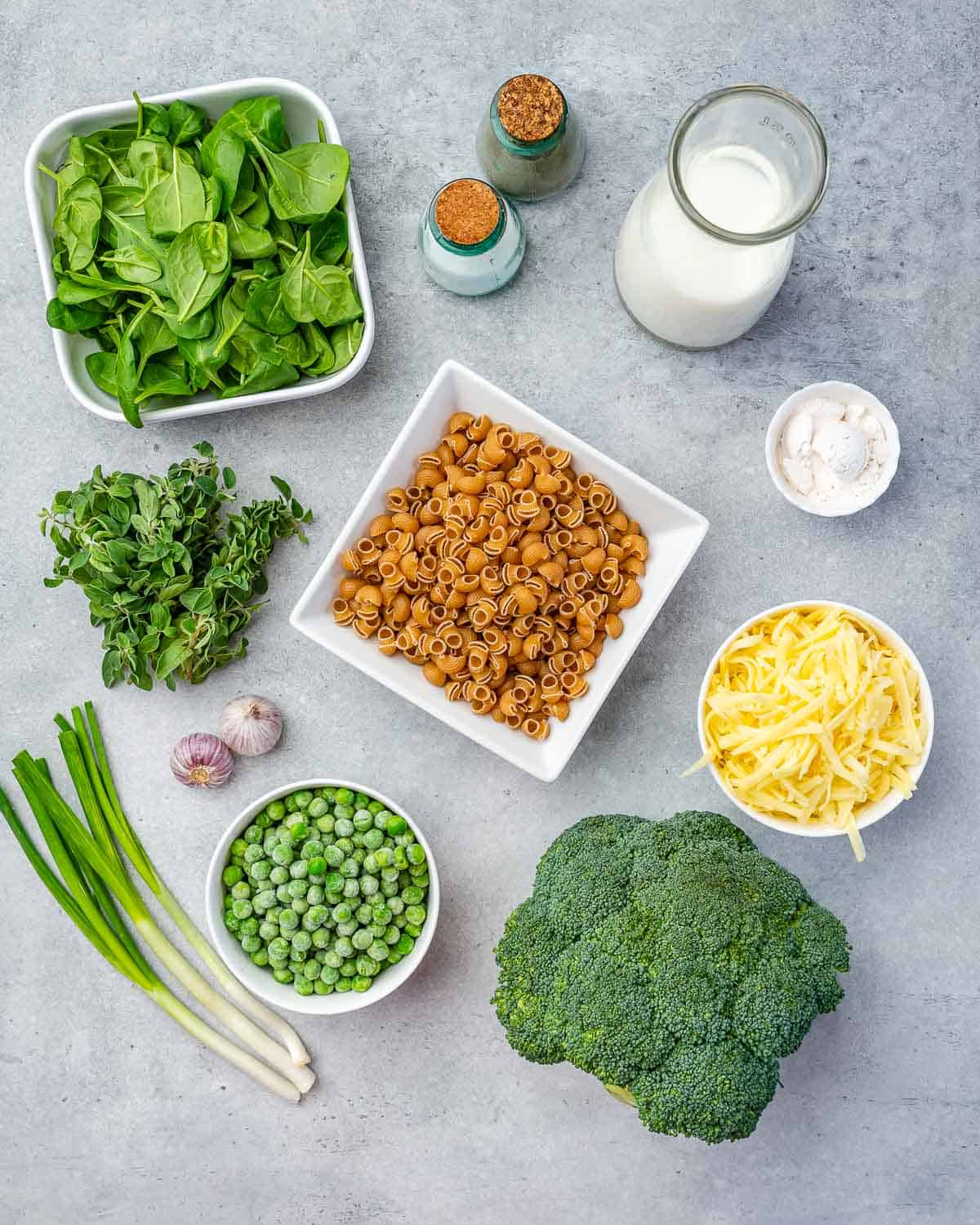 Ingredients for green mac and cheese on counter.