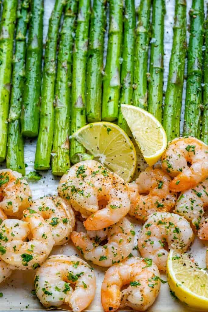 close up view of garlic shrimp and asparagus