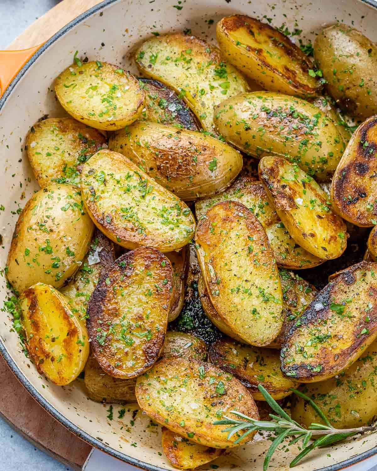 top view of roasted potatoes in an orange skillet