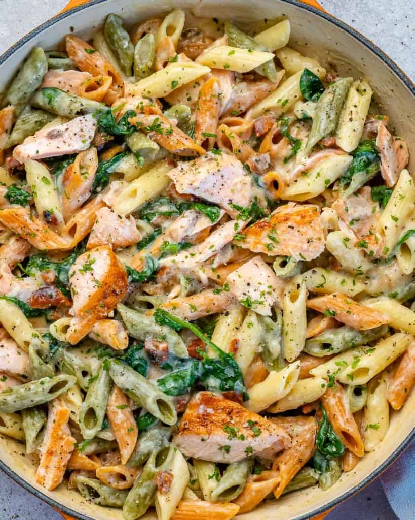 top view salmon pasta in a skillet