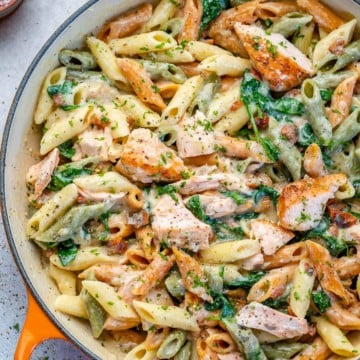 top view salmon pasta in an orange skillet