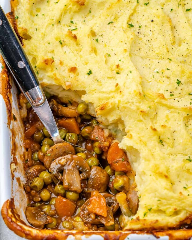 close up shepherd's pie with spoon in dish
