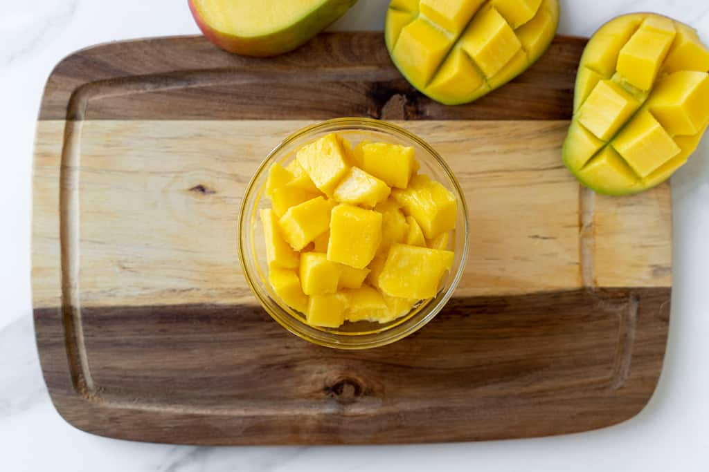 top view of chopped mango cubes in a bowl