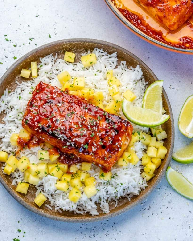 top view pan seared salmon over a bed of rice and pineapple chunks