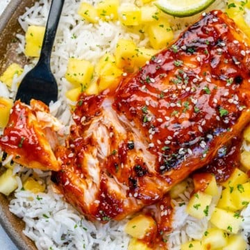 close up bbq chicken over rice with mango salsa