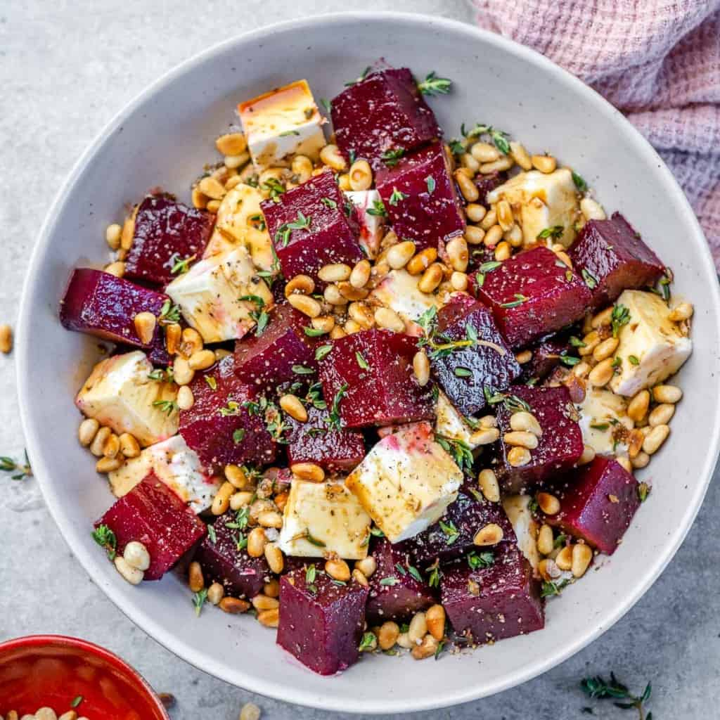 top view beet salad in a white bowl
