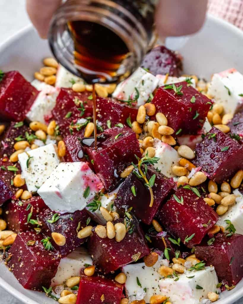 Close view of beet salad in bowl with balsamic vinegar