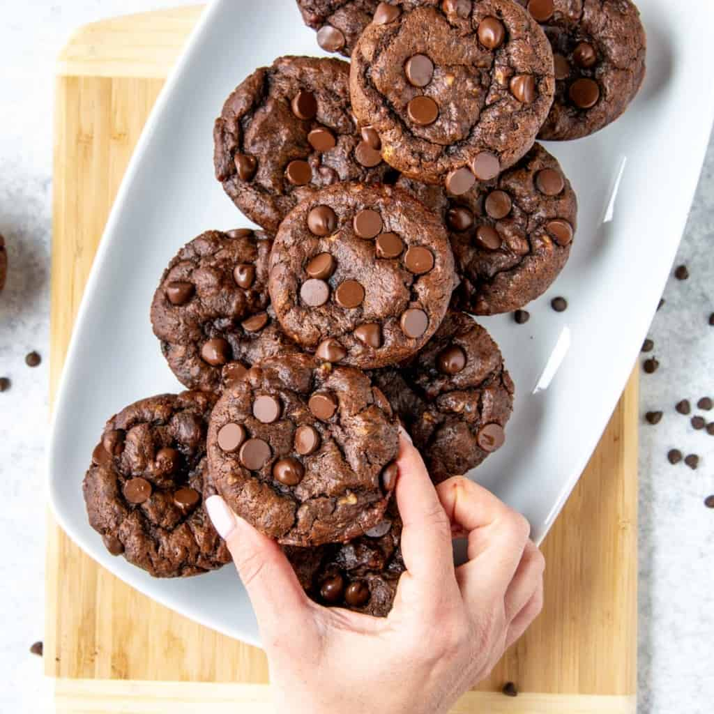 hand reaching for chocolate chip muffins