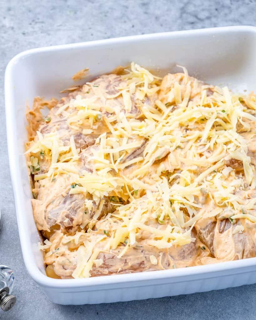 Raw chicken in white dish