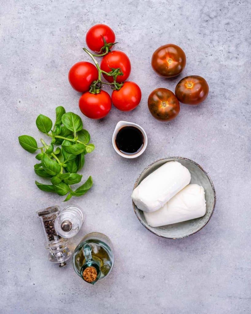 Salt, pepper, balsamic glaze, basil, tomatoes, and mozzarella for caprese salad recipe