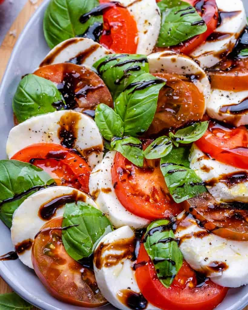 Close image of caprese salad on plate with balsamic drizzle
