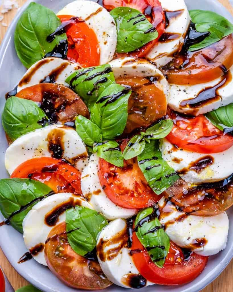 Fresh caprese salad with basil and balsamic drizzle on plate