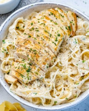top view chicken alfredo in a white bowl