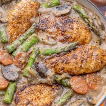 Chicken in pan with asparagus, celery, carrots, mushrooms, and other ingredients
