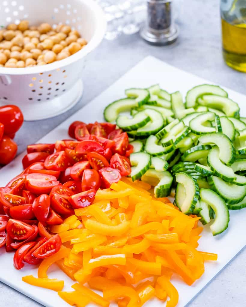 chopped tomatoes, bell peppers and cucumbers on a platter